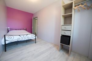 Un ou plusieurs lits dans un hébergement de l'établissement Appart Hotel de la Souleuvre