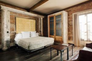 Letto o letti in una camera di Aparthotel Arai 4* Superior