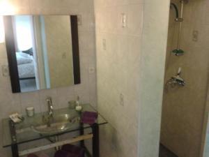 A bathroom at Chambres d'hôtes La Prairie