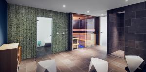 Een badkamer bij Inntel Hotels Amsterdam Centre