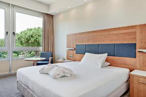 Letto o letti in una camera di Italiana Hotels Florence