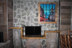 Una televisión o centro de entretenimiento en Apartamentos Numancia