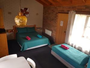 A bed or beds in a room at Walkabout Motel