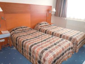 Un ou plusieurs lits dans un hébergement de l'établissement The Originals City, Hôtel Le Bellevue, Montrichard (Inter-Hotel)