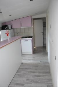 "A kitchen or kitchenette at Apartments ""NONO"""