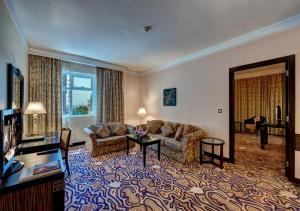 Гостиная зона в Sharjah Palace Hotel