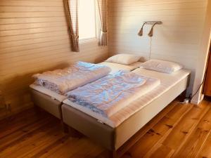 Säng eller sängar i ett rum på Doro Camp Lapland