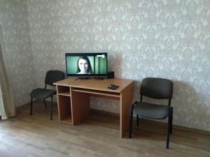 Телевизор и/или развлекательный центр в Kvartira na Vspoliye 9