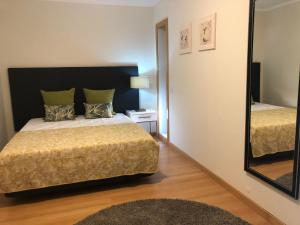 A bed or beds in a room at Ria Formosa