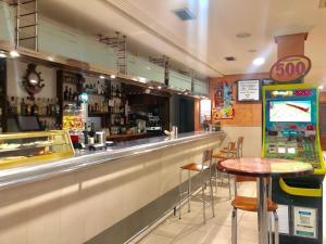 The lounge or bar area at Hostal Sanpatiel
