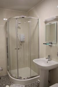 A bathroom at Abbey Grange Hotel