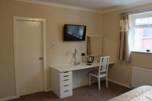 A television and/or entertainment center at Abbey Grange Hotel