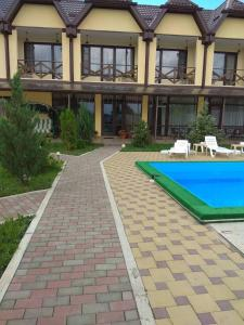 The swimming pool at or near Guest House Assol