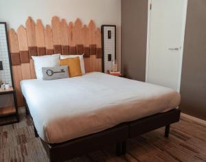 Un ou plusieurs lits dans un hébergement de l'établissement Mr. Jordaan