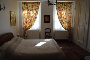 A bed or beds in a room at La Promenade