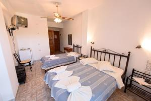 Ένα ή περισσότερα κρεβάτια σε δωμάτιο στο Βίλλα Μάρα