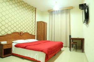 A bed or beds in a room at Emirates Plaza Hotel