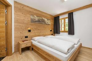 A bed or beds in a room at Residence Rottonara