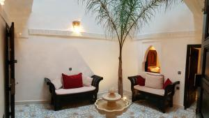 Ein Sitzbereich in der Unterkunft Riad Africa
