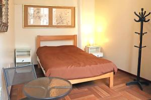 A bed or beds in a room at 1900 Hostel