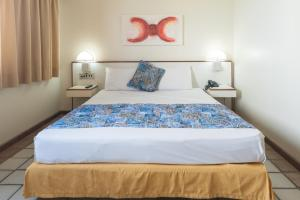 A bed or beds in a room at Dan Inn Recife Mar