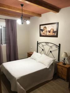 Ein Bett oder Betten in einem Zimmer der Unterkunft El Rancho
