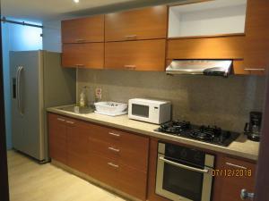 A cozinha ou cozinha compacta de Tamarindo Centro Vip Apartment