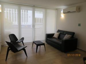 Uma área de estar em Tamarindo Centro Vip Apartment