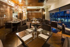 A restaurant or other place to eat at Novotel Canberra