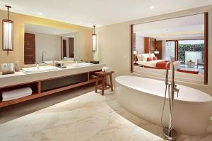 A bathroom at The Bandha Hotel & Suites