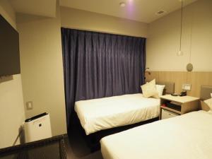 Letto o letti in una camera di Haneda Inn
