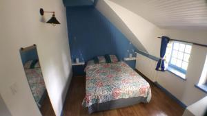 Un ou plusieurs lits dans un hébergement de l'établissement Ty-yado