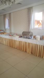 Restauracja lub miejsce do jedzenia w obiekcie URychertow