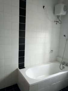 A bathroom at Deluxe Suites Superior Accommodation
