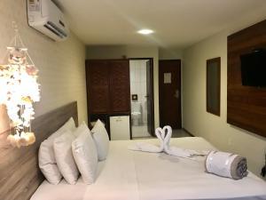 Cama ou camas em um quarto em Pousada Flor de Maraca