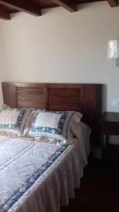 A bed or beds in a room at Casa Lola