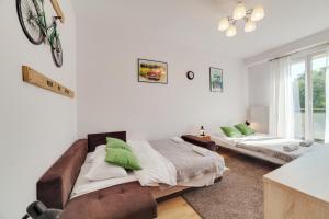 Łóżko lub łóżka w pokoju w obiekcie Dream Loft Rajska