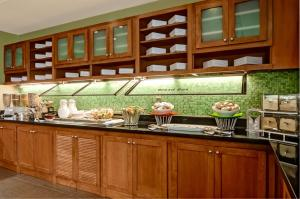 A kitchen or kitchenette at Hyatt Place Fort Lauderdale Cruise Port