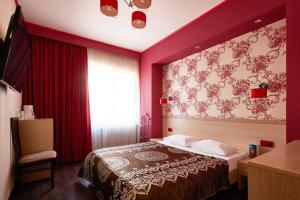 Кровать или кровати в номере Отель Таёжный