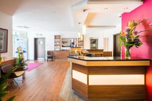 The lobby or reception area at Best Western Hotel Breitbach