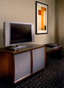 A television and/or entertainment center at The Highland Dallas, Curio Collection by Hilton