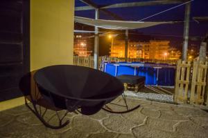 The swimming pool at or near Hostel Casa das Regadas