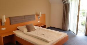Ein Bett oder Betten in einem Zimmer der Unterkunft Frühstückspension Winter