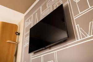 A television and/or entertainment centre at ibis Coventry Centre