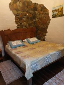 Кровать или кровати в номере Река Времени