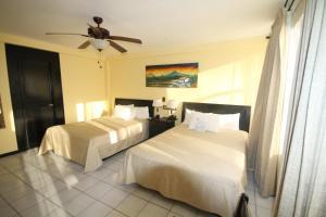 Cama o camas de una habitación en Best Western El Sitio Hotel & Casino