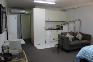 A kitchen or kitchenette at Box Hill Studio Apartment 2