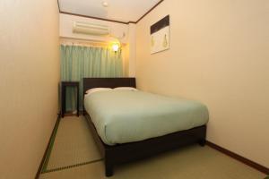 Tempat tidur dalam kamar di Hostel Zen