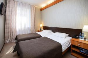 A bed or beds in a room at Park Hotel Bely Sobol