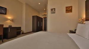 Ein Bett oder Betten in einem Zimmer der Unterkunft TANA Hotel